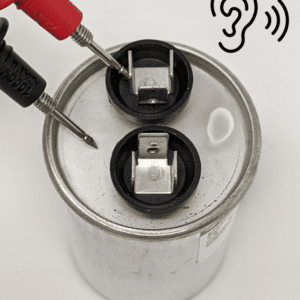 Figure 10a. To test electrical continuity between the dielectric layers and the capacitor housing, place one multimeter probe on the first tab and the second probe on the housing.
