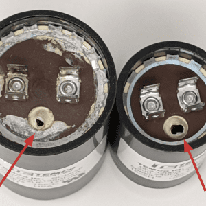 Figure 8. Two capacitors with the relief port blown (highlighted with arrow). This relief port is designed to fail to keep the capacitor from exploding. These should be discarded after taking a photo of the label.
