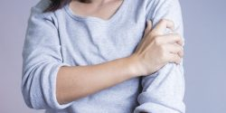 Woman with a sore arm