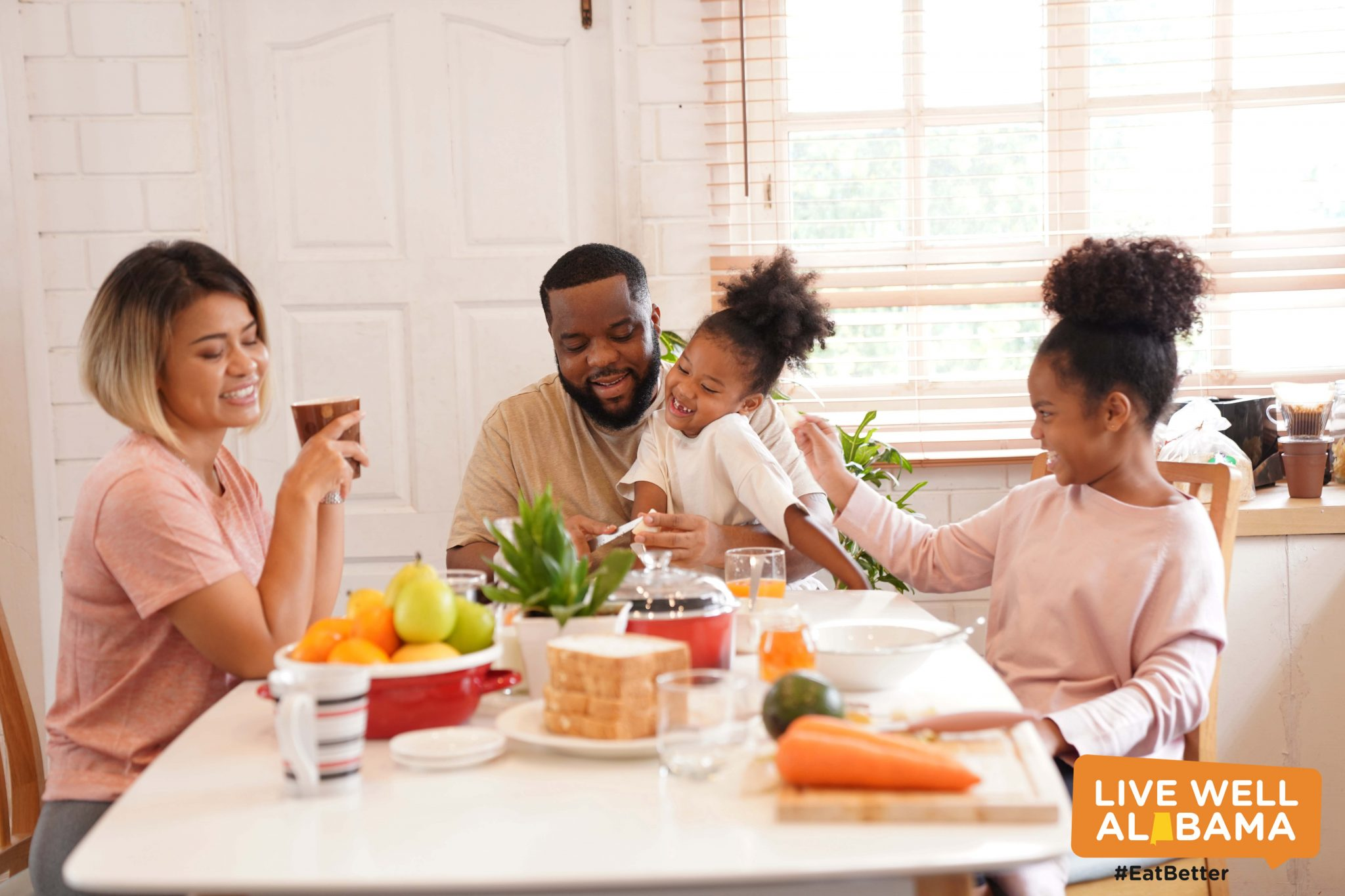 family sitting at table eating breakfast