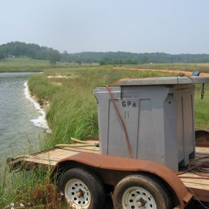Figure 4. Following acclimation, shrimp postlarvae are transported from nursery tanks to production ponds where they are released for grow out.