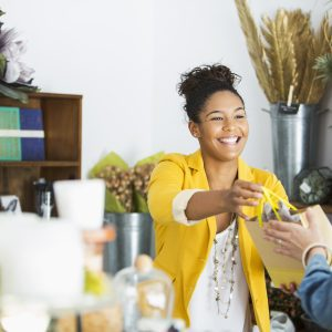 Young black saleswoman helping a customer