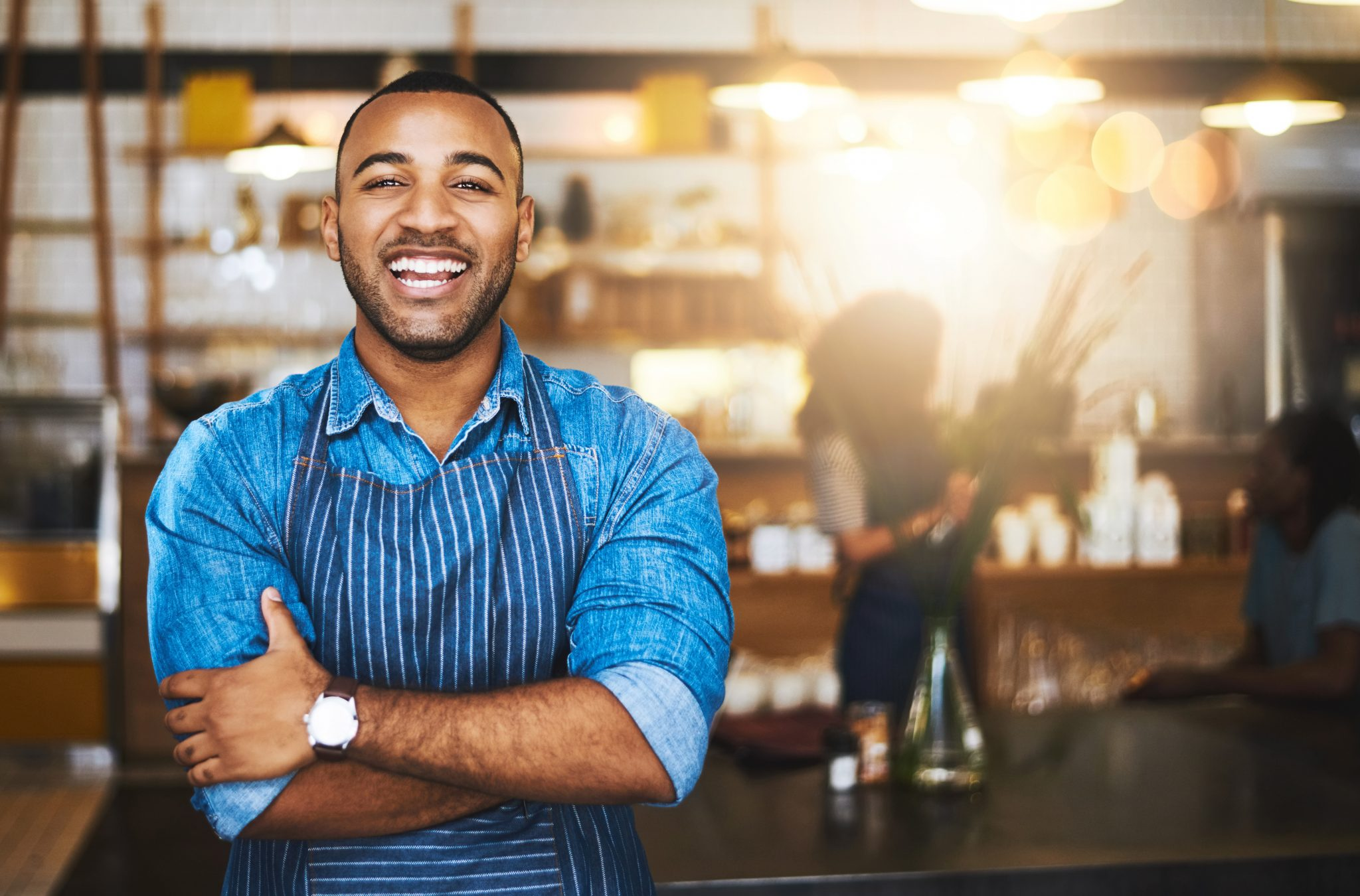 Young black man with an apron on