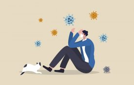 Illustrated man with COVID virus around him