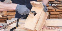 Closeup of hands building a bird house