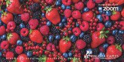 Closeup of fresh strawberries, blueberries, black berries, and raspberries.
