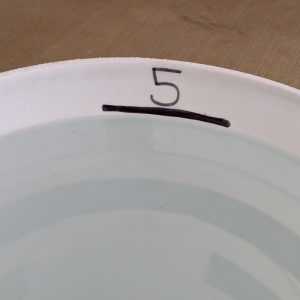 Figure 5. Use the top of the water line to mark the 5-gallon level.