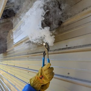 Figure 4. Slowly move the smoke emitter along the outside of the house.