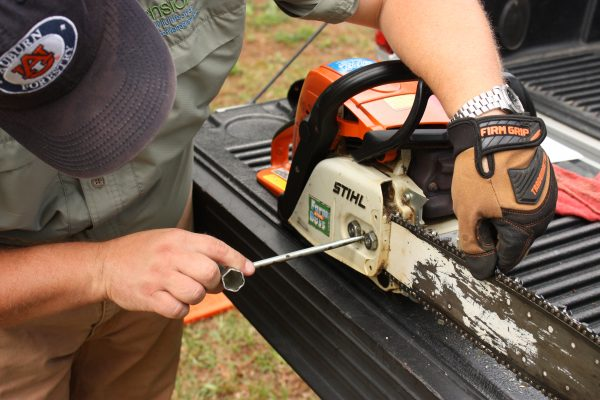 Figure 11. Gloves should be worn when performing saw maintenance.