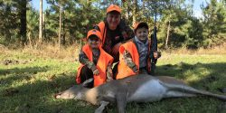 Dr. Mark Smith hunting deer with twin sons